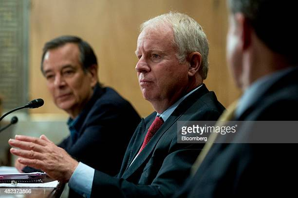 David Pyott former chairman and chief executive officer of Allergan Inc center speaks during a Senate Permanent Subcommittee on Investigations...