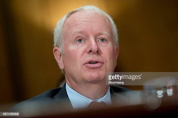 David Pyott former chairman and chief executive officer of Allergan Inc listens during a Senate Permanent Subcommittee on Investigations hearing in...