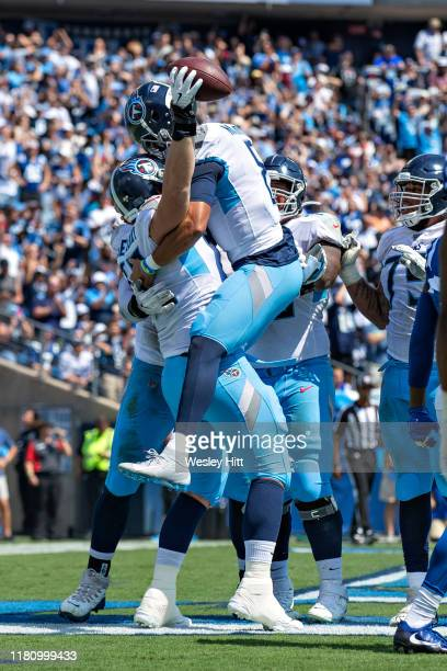 David Quessenberry and Marcus Mariota of the Tennessee Titans celebrate after catcheing a pass in the end zone for touchdown during a game against...