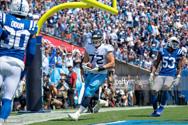 David Quessenberry of the Tennessee Titans catches a pass in the end zone for touchdown during a game against the Indianapolis Colts at Nissan...