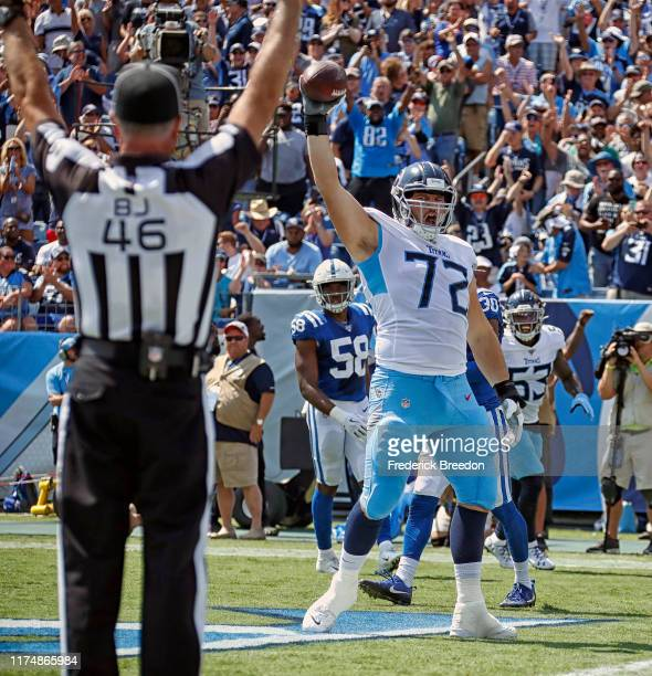 David Quessenberry of the Tennessee Titans celebrates after making a touchdown reception against the Indianapolis Colts during the first half at...