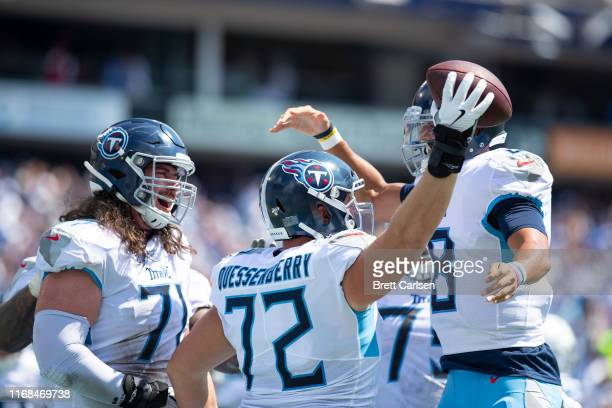 David Quessenberry of the Tennessee Titans celebrates his touchdown reception with Marcus Mariota during the second quarter against the Indianapolis...
