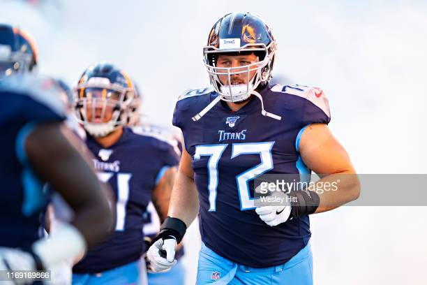David Quessenberry of the Tennessee Titans jogs onto the field before a game against the New England Patriots during week two of the preseason at...