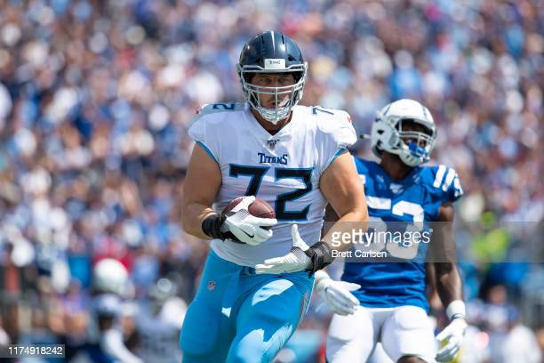 David Quessenberry of the Tennessee Titans makes a touchdown reception during the second quarter against the Indianapolis Colts at Nissan Stadium on...