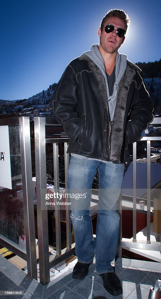 David Quinney, Owner of Fanology Social from Los Angeles, wearing Ray Ban aviator sunglasses, Robert Comsock sheeps hair jacket, Allsaints sweatshirt, Diesel jeans, and Kenneth Cole boots on January 20, 2013 on the streets of Park City, Utah.
