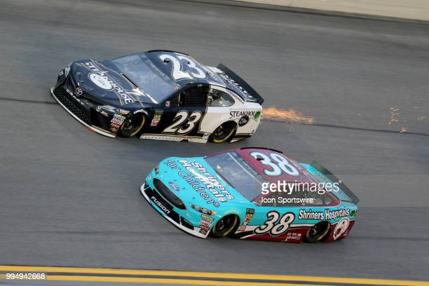 David Ragan and JJ Yeley race in turn 3 during the Coke Zero 400 Monster Energy Cup Series race on July 7 at Daytona International Speedway in...