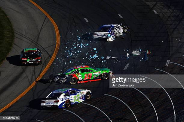 David Ragan driver of the Aaron's Dream Machine Toyota and Danica Patrick driver of the GoDaddy Chevrolet are involved in an ontrack incident during...