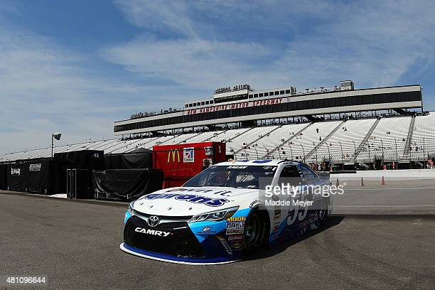 David Ragan driver of the Aaron's Dream Machine Toyota drives through the garage area during practice for the NASCAR Sprint Cup Series 5Hour Energy...