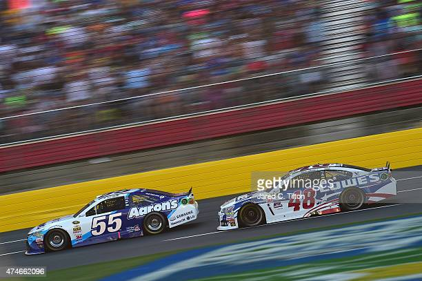 David Ragan driver of the Aaron's Dream Machine Toyota leads Jimmie Johnson driver of the Lowe's Patriotic Chevrolet during the NASCAR Sprint Cup...