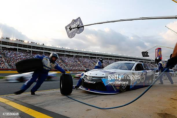 David Ragan driver of the Aaron's Dream Machine Toyota pits during the NASCAR Sprint Cup Series Sprint Showdown at Charlotte Motor Speedway on May 15...