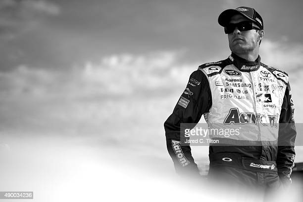 David Ragan driver of the Aaron's Dream Machine Toyota stands on the grid during qualifying for the NASCAR Sprint Cup Series Sylvania 300 at New...