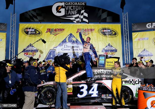 David Ragan driver of the Farm Rich Ford celebrates in victory lane after winning the NASCAR Sprint Cup Series Aaron's 499 at Talladega Superspeedway...