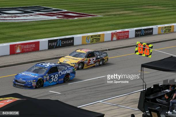 David Ragan driver of the Overton's Ford and Matt DiBenedetto driver of the CanAm/Kappa Ford drive down pit road during the Monster Energy NASCAR Cup...
