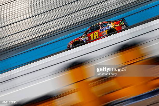 David Ragan driver of the Snickers Extreme Toyota drives during practice for the NASCAR Sprint Cup Series CampingWorldcom 500 at Phoenix...
