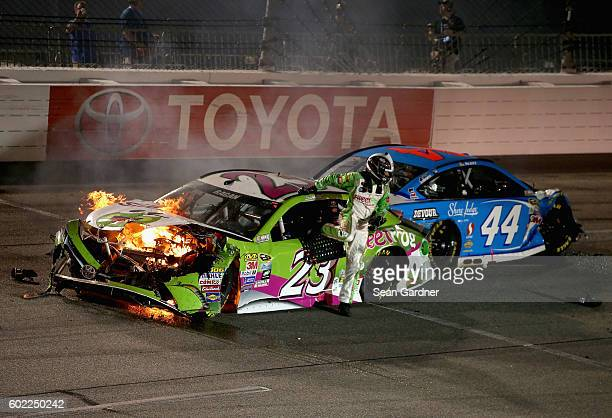 David Ragan driver of the sweetFrog Toyota gets out of his car after an ontrack incident during the NASCAR Sprint Cup Series Federated Auto Parts 400...