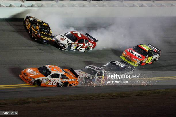 David Ragan driver of the UPS Ford and Robby Gordon driver of the Jim Beam Dodge crash while Joey Logano driver of the Home Depot Toyota and Scott...