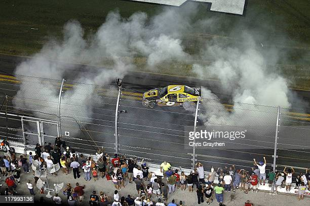 David Ragan driver of the UPS Ford celebrates after winning the NASCAR Sprint Cup Series Coke ZERO 400 Powered by CocaCola at Daytona International...