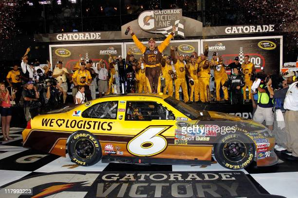 David Ragan driver of the UPS Ford celebrates with his crew in victory lane after he won the NASCAR Sprint Cup Series Coke ZERO 400 Powered by...