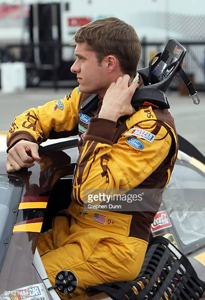 David Ragan driver of the UPS Ford climbs out oif his car after qualifying for the NASCAR Sprint Cup Series Shelby American at Las Vegas Motor...