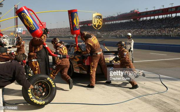 David Ragan driver of the UPS Ford comes in for a pit stop during the NASCAR Sprint Cup Series Pepsi 500 at Auto Club Speedway on October 11 2009 in...