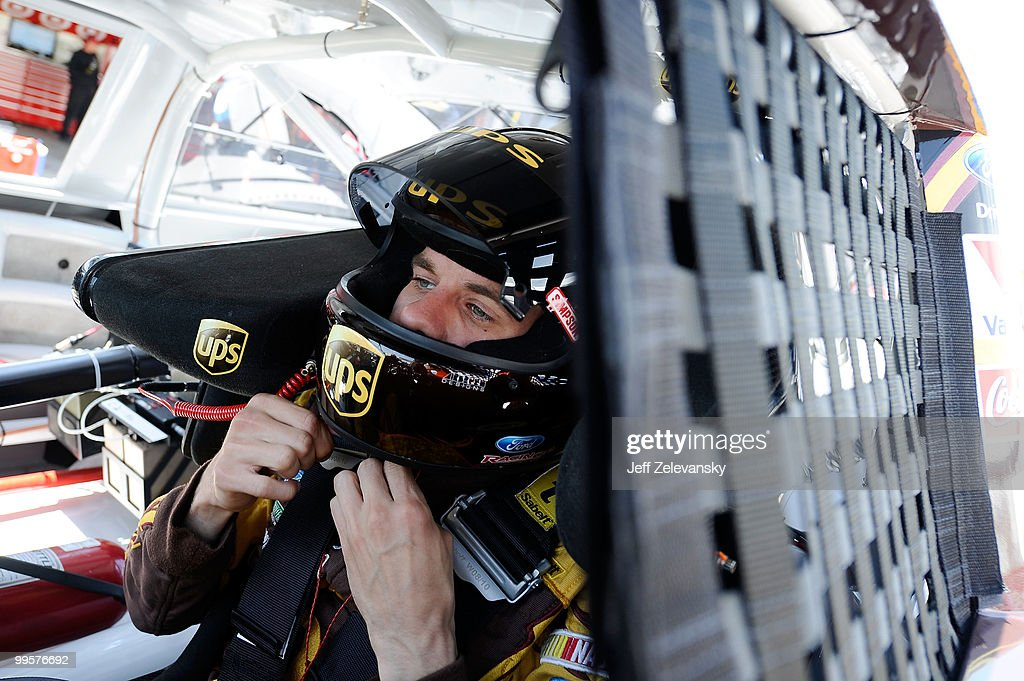 David Ragan, driver of the #6 UPS Ford, sit in his car during practice for the NASCAR Sprint Cup Series Autism Speaks 400 at Dover International Speedway on May 15, 2010 in Dover, Delaware.