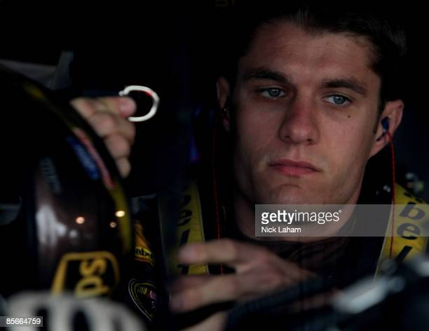 David Ragan driver of the UPS Ford sits in his car during practice for the NASCAR Sprint Cup Series Goody�s Fast Pain Relief 500 at the Martinsville...