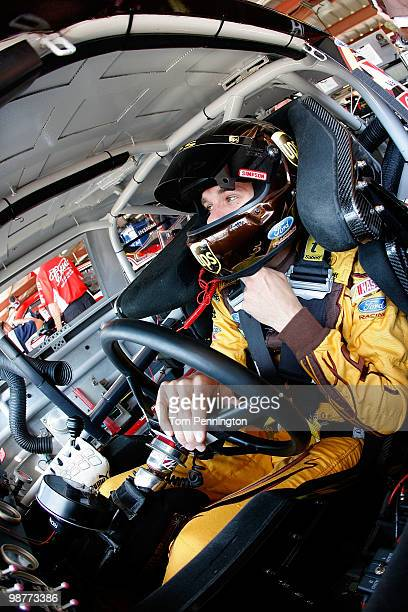David Ragan driver of the UPS Ford sits in his car during practice for the NASCAR Sprint Cup Series Crown Royal Presents the Heath Calhoun 400 at...