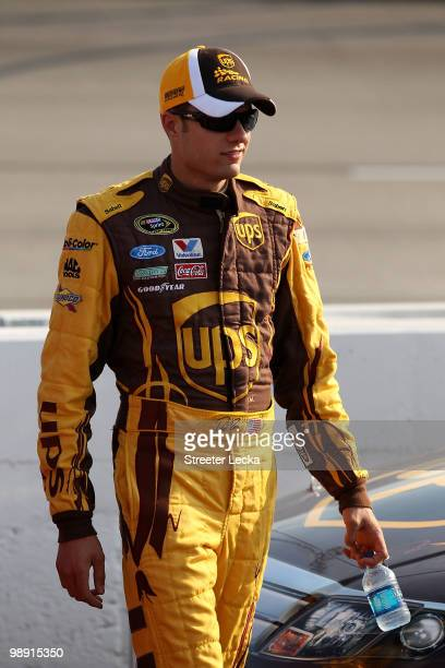 David Ragan driver of the UPS Ford walks on the grid during qualifying for the NASCAR Sprint Cup Series SHOWTIME Southern 500 at Darlington Raceway...