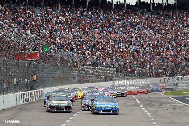 David Ragan driver of the UPS My Choice Ford and Greg Biffle driver of the 3M ScotchBlue Painter's Tape Ford lead the field at the start of the...