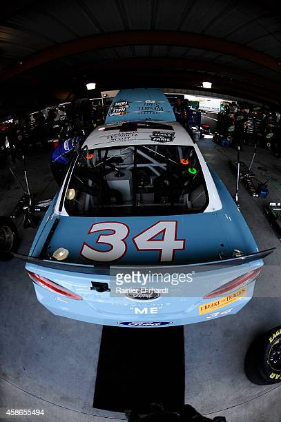 David Ragan, driver of the Wendell Scott Hall of Fame Tribute Ford, stands in the garage area during practice for the NASCAR Sprint Cup Series...