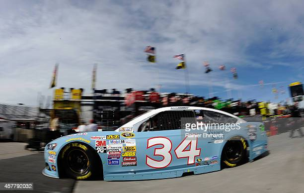 David Ragan, driver of the Wendell Scott Hall of Fame Tribute Ford, drives through the garage area during practice for the NASCAR Sprint Cup Series...
