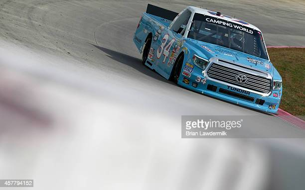 David Ragan, driver of the Wendell Scott Hall of Fame Tribute Ford, practices for the NASCAR Camping World Truck Series Kroger 200 at Martinsville...