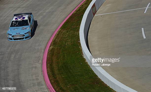 David Ragan, driver of the Wendell Scott Hall of Fame Tribute Ford, practices for the NASCAR Sprint Cup Series Goody's Headache Relief Shot 500 at...