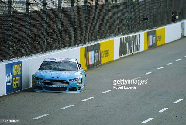 David Ragan, driver of the Wendell Scott Hall of Fame Tribute Ford, qualifies for the NASCAR Sprint Cup Series Goody's Headache Relief Shot 500 at...