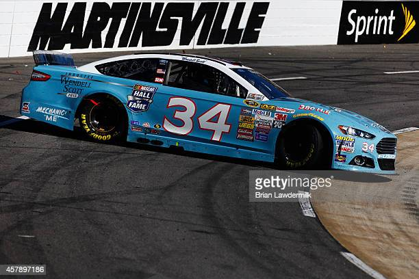 David Ragan driver of the Wendell Scott Hall of Fame Tribute Ford spins during the NASCAR Sprint Cup Series Goody's Headache Relief Shot 500 at...
