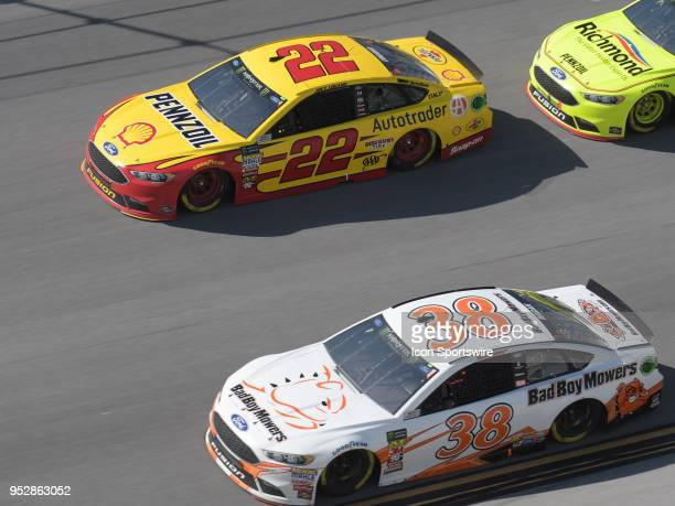 David Ragan Front Row Motorsports Ford Fusion Bad Boy Mowers and Joey Logano Team Penske Ford Fusion Shell Pennzoil race side by side during the...