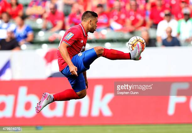David Ramirez of Costa Rica jumps to control the ball against Jamaica in their CONCACAF Gold Cup Group B match at StubHub Center on July 8 2015 in...