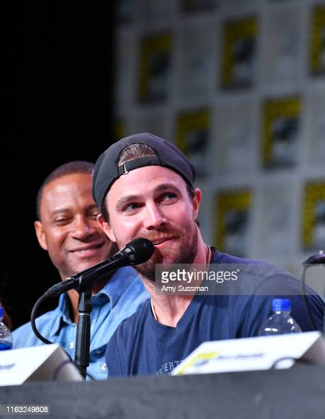 David Ramsey and Stephen Amell speak at the Arrow Special Video Presentation And QA during 2019 ComicCon International at San Diego Convention Center...