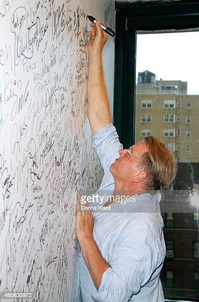 David Rasche signs the wall after discussing 'Impastor' during the AOL Build Series at AOL Studios In New York on July 13 2015 in New York City