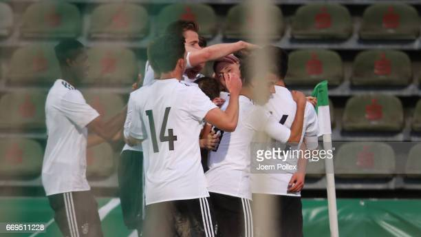 David Raum of Germany celebrates with his team mates after scoring his team's second goal during the international friendly between U19 Germany and...