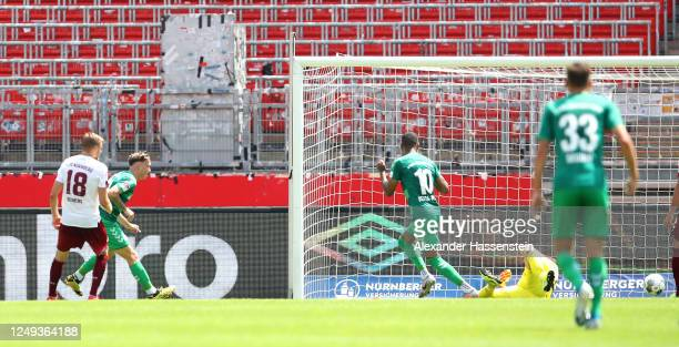 David Raum of SpVgg Greuther Fuerth scores his team's first goal during the Second Bundesliga match between 1. FC Nürnberg and SpVgg Greuther Fürth...
