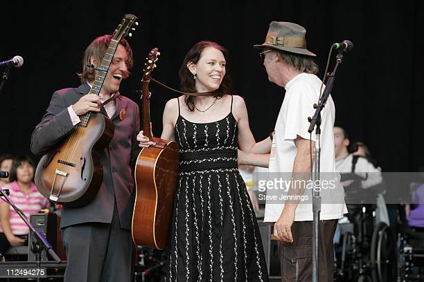 David Rawlings Gillian Welch and Neil Young during 20th Annual Bridge School Benefit Concert Day One at Shoreline Amphitheatre in Mountain View...