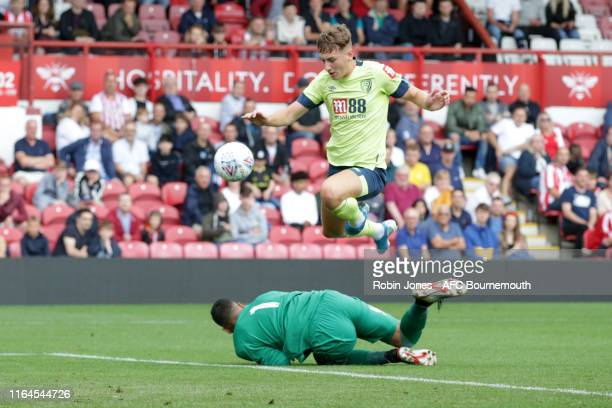 David Raya of Brentford stops David Brooks of Bournemouth during the Pre-Season Friendly match between Brentford and AFC Bournemouth at Griffin Park...