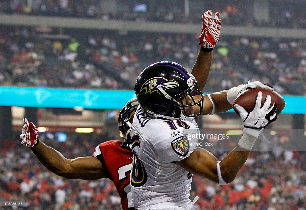 David Reed #16 of the Baltimore Ravens pulls in this reception against Chris Owens #21 of the Atlanta Falcons before Reed was called for offensive pass interference at Georgia Dome on September 1, 2011 in Atlanta, Georgia.