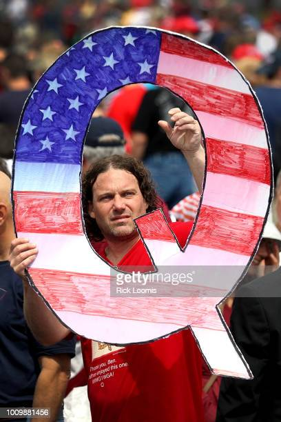 David Reinert holds up a large Q sign while waiting in line to see President Donald J Trump speak on August 2 2018 at the Mohegan Sun Arena at Casey...