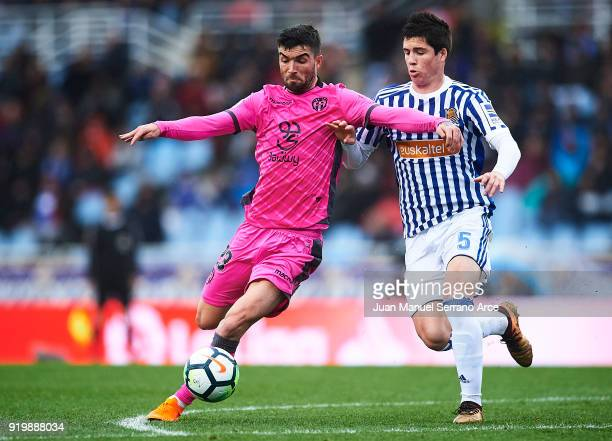 David Remeseiro 'Jason' of Levante UD competes for the ball with Igor Zubeldia of Real Sociedad during the La Liga match between Real Sociedad and...