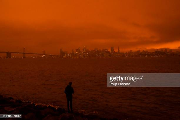 David Ren of Berkeley, California takes in the view as smoke from various wildfires burning across Northern California mixes with the marine layer,...
