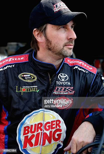 David Reutimann driver of the Burger King/Dr Pepper Toyota stands in the garage area during practice for the NASCAR Sprint Cup Series Goody's...
