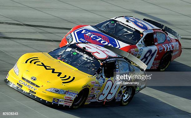 David Reutimann driver of the XM Radio Toytoa and Kevin Hamlin driver of the Vector Security Dodge race during the NASCAR Nationwide Series Camping...
