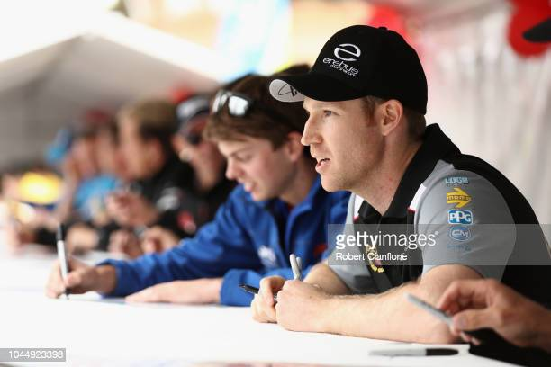 David Reynolds driver of the Erebus Penrite Racing Holden Commodore ZB is seen during an autograph session during previews ahead of the Bathurst 1000...